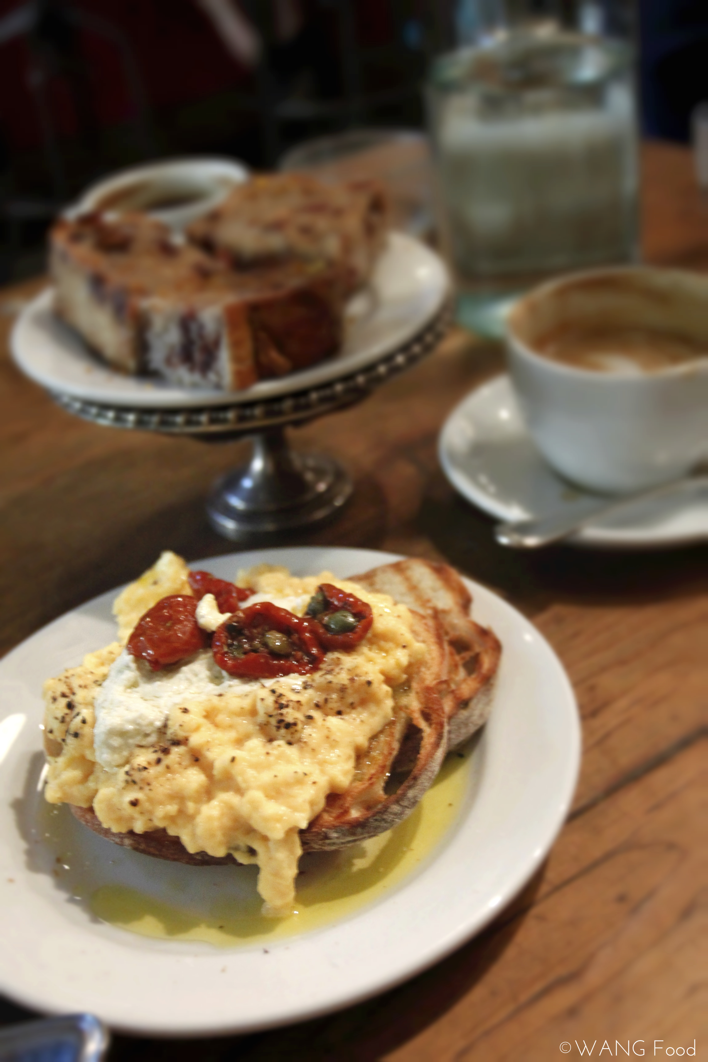 steamed eggs with sun-dried tomatoes and goat cheese